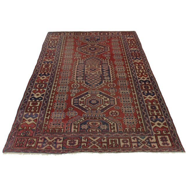 Offered is a Persian Bidjar area rug in tones of red, tan and navy. The hand knotted wool pile features geometric designs...