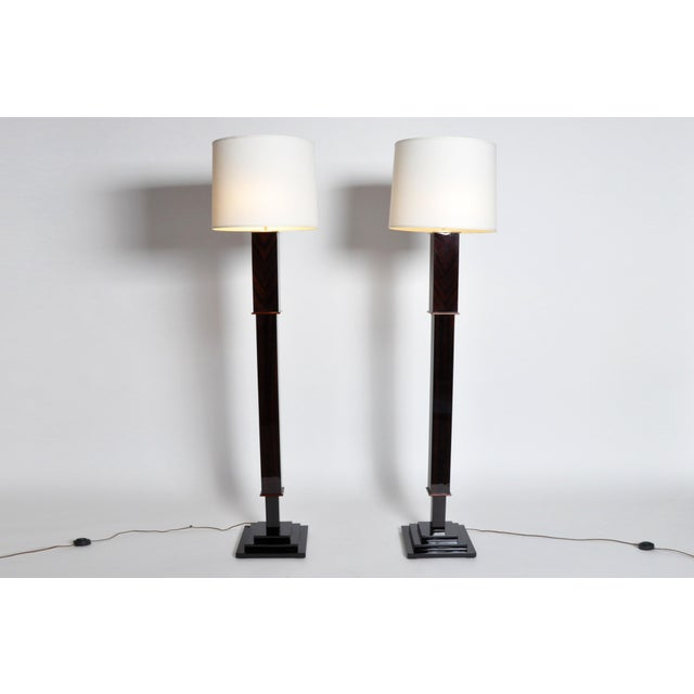 This elegant pair of floor lamps is from Hungary and is made from walnut veneer. They both feature a step base.