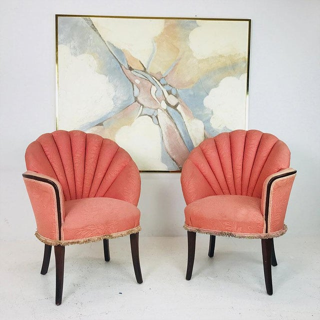 Pair of deco opposing channel back chairs. Chairs are in good vintage condtion with original fabric. Refinishing & new...