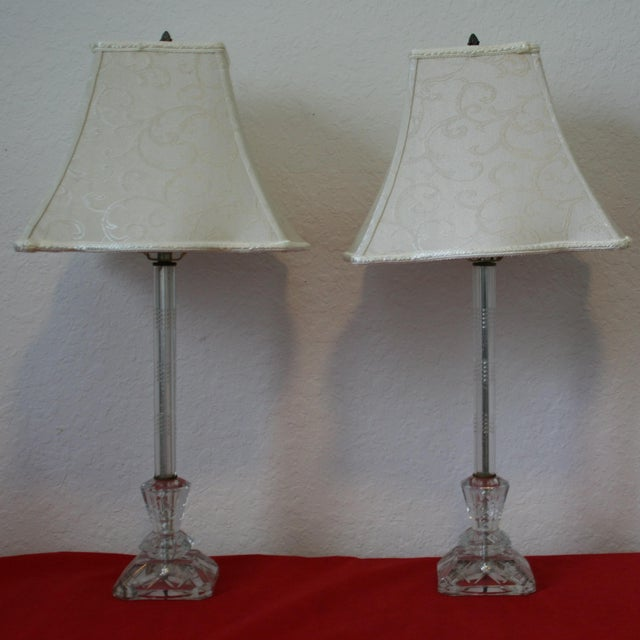 Original from the 1930s - 1940's and used in bedrooms during that period. This pair of lamps are cut glass with a detailed...