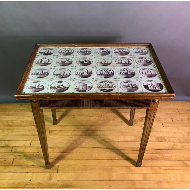 A perfectly proportioned late 19th century tile top table, probably Scandinavian, in the Louis XVI style with delicately...