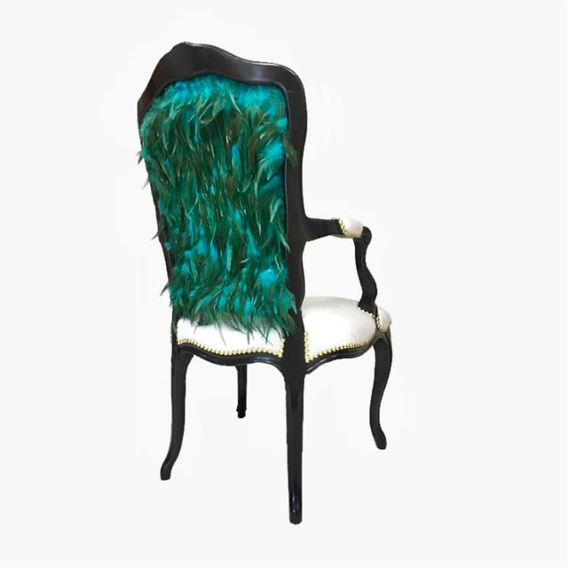 High– back French style open-arm chair with intricate floral carved details, midnight black finish. Luxurious faux mink...