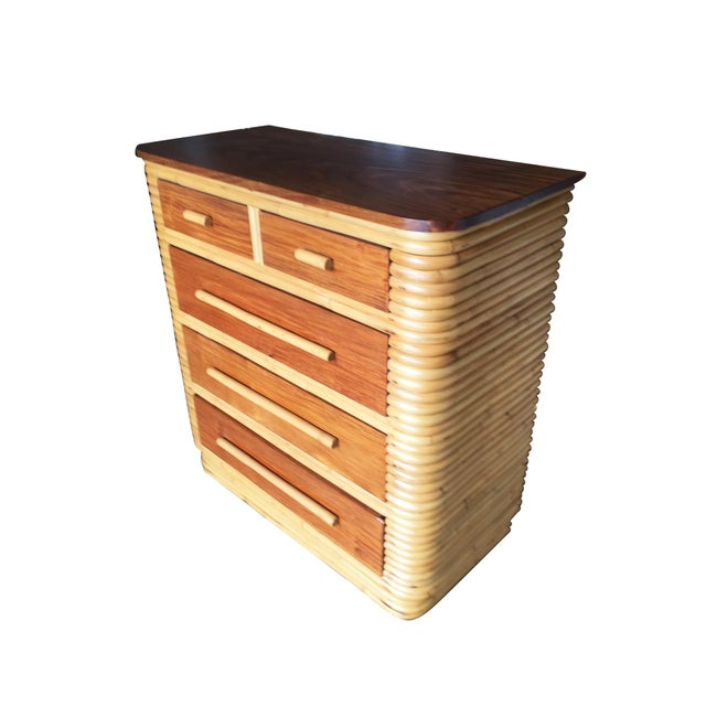 Stacked rattan Highboy dresser with a mahogany top and five pull out drawers. Circa 1970. Stacked rattan and mahogany...