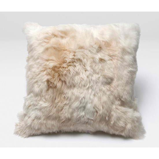 A throw pillow covered in baby alpaca fur, with a blended down insert - how completely luxurious. This cream-colored throw...