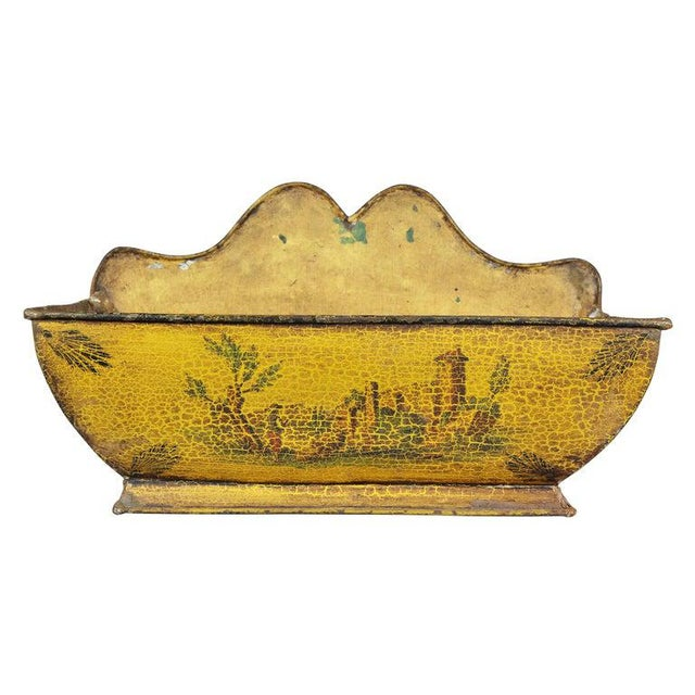 With a removable cover with gallery and finial, tapered body with spigot lacking handle, all above the rectangular basin.