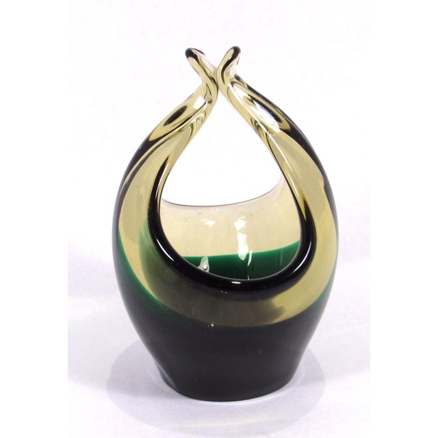 A vintage Cenedese Murano hand-blown green and amber art glass basket bowl. The bowl was made using the Sommerso...