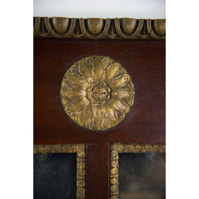 Create a royal, high class aesthetic over your fireplace with this large Regency style mahogany mantel mirror. The gilt...