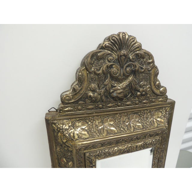 Antique embossed brass vanity reliquary with mirrored door and coat brushes. Antique repose vanity reliquary in brass...