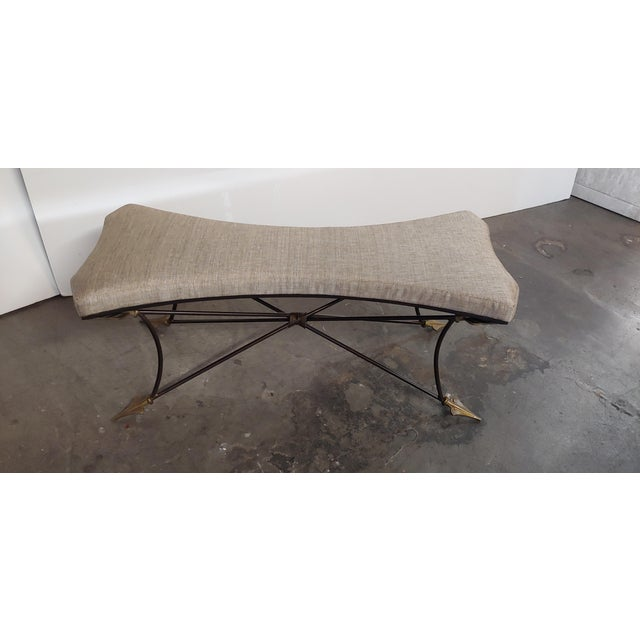 Bench with a metal Italian Neoclassical style base circa 1960s. Featuring a new seat with new cotton blend fabric. Arrows...