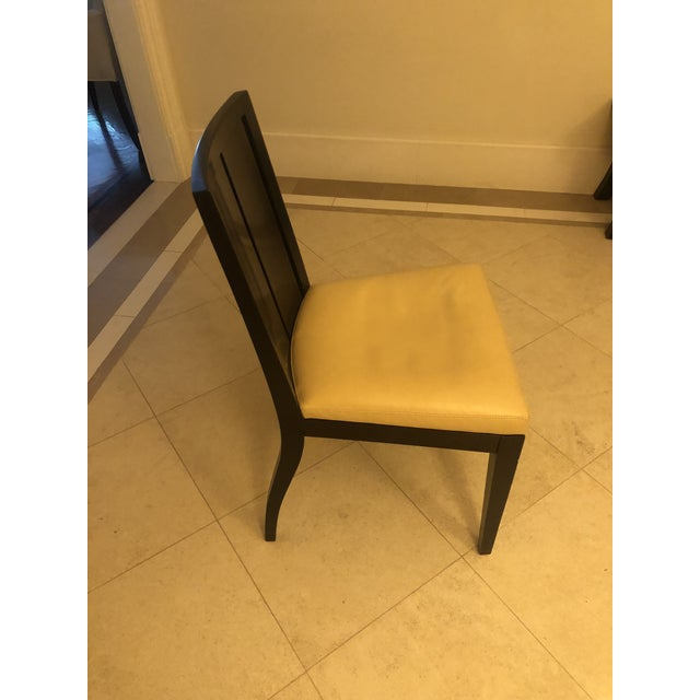 """A classic interpretation with a tailored modern aesthetic. A pair of side chairs with Hermes Leather """"Rivage in cream/off..."""