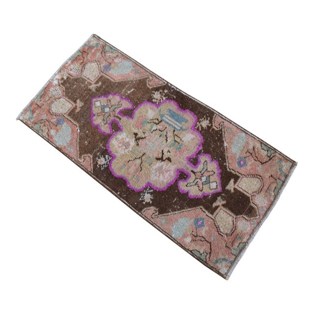 a Vintage brown background color small rug perfect for a small guest bath or in front of the kitchen sink Dimensions:...