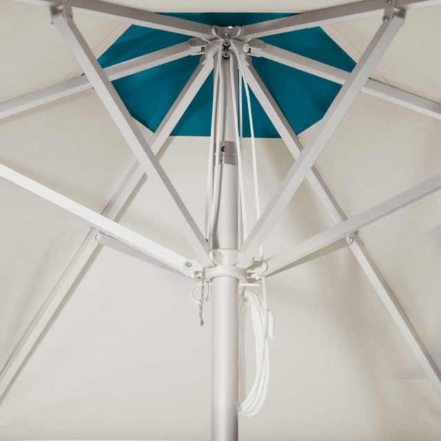 The Blueberry Smoothie Market Umbrella is a 9' Hexagon in Aluminum. The umbrella's main canopy is fabricated in Whipped...
