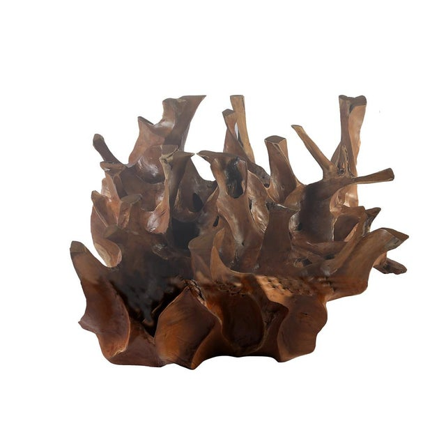 Inspired by the beauty of natural root form, this organic teak coffee table is handcrafted from one piece of salvaged teak...