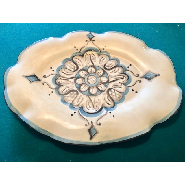 Gorgeous porcelain platter with waves shaped around.