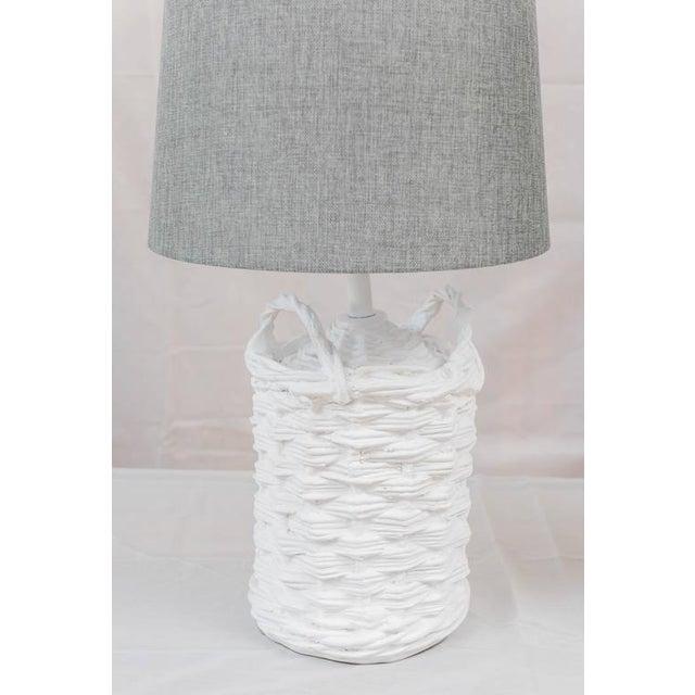 A pair circa 1970's White plaster wine jug basket style lamp by the legendary San Francisco designer John Dickinson....