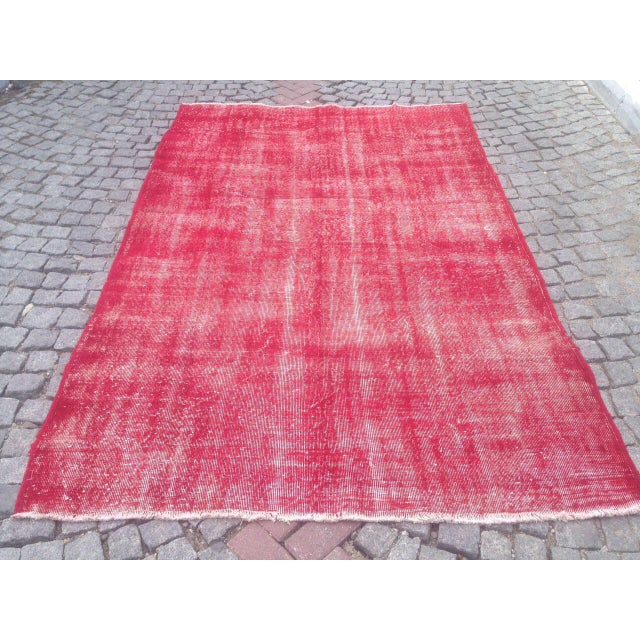 This is a Turkish Anatolian pink overdyed, hand knotted rug made with wool on cotton. It is in very good condition and...