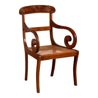 Javanese Antique Armchair with Carved Rail, Woven Rattan Seat and Curving Arms For Sale