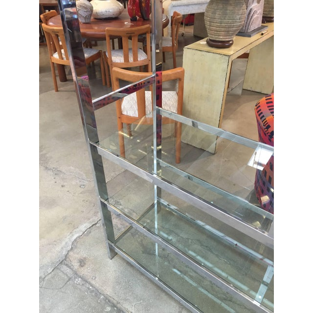 A Milo Baughman attributed etagere in excellent condition. Glass and chrome have a few scratches from wear and use. The...