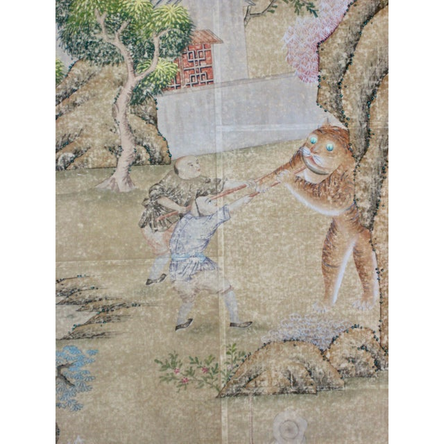 Large frame with beautiful Chinese hand painted wall paper. Representing a mythological scene or a hunting scene with a...