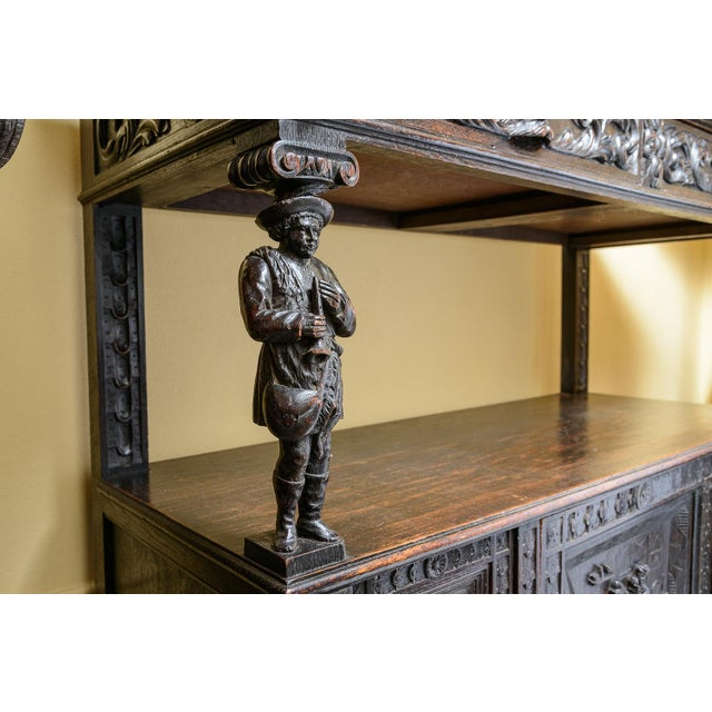 Beautiful, antique English, dumb waiter. Lovely carved details of people, animal heads and fruit panels. Storage of two...