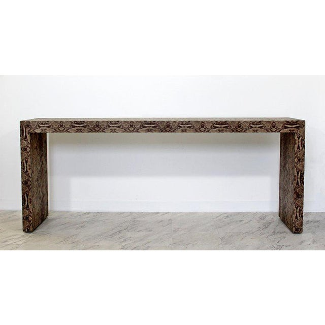 For your consideration is a sexy, unique Parsons console table, covered in faux python snakeskin circa 1970s. In excellent...