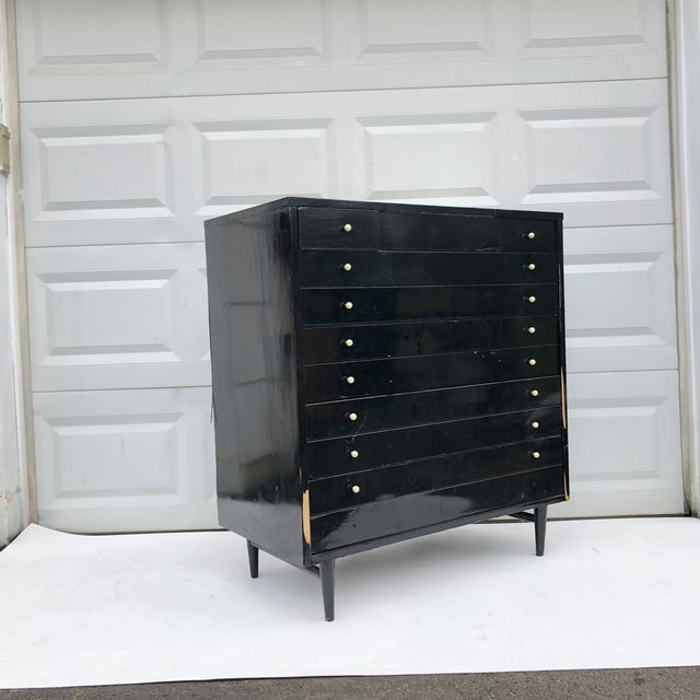 This striking mid-century modern highboy dresser by American of Martinsville features black lacquer finish complimented by...