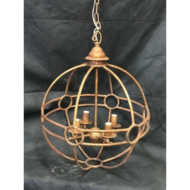 This is an Italian iron globe 4-light chandelier. The round design is a classic Italian theme over a square or rectangular...