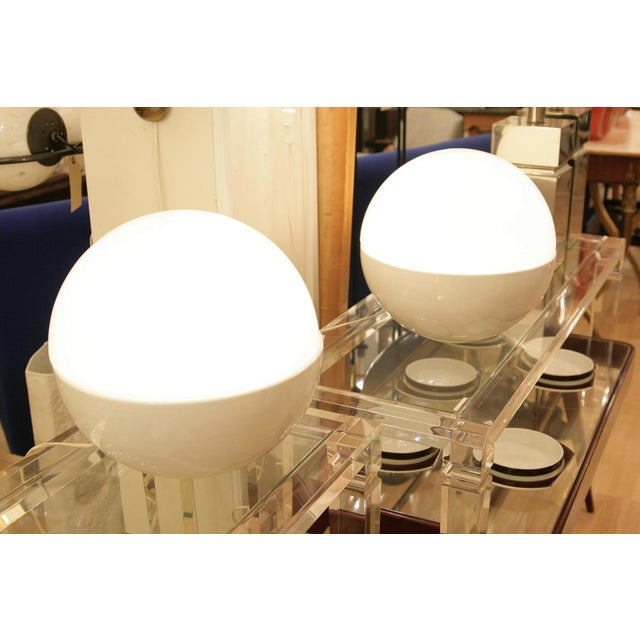 A good pair of Iconic 1960's design lights glass shade on a ceramic base spherical shape.Design by Alvino Bagni...