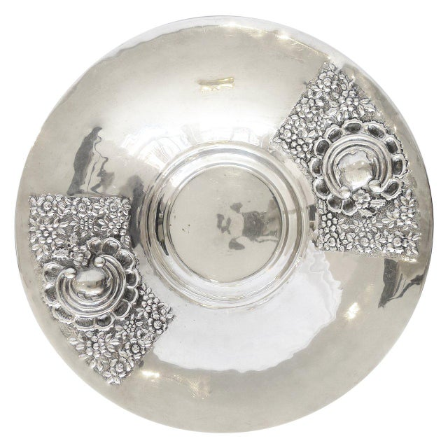 Extra large silver serving bowl with repoussé flower design. No markings. Perfect filled with ice to present caviar.