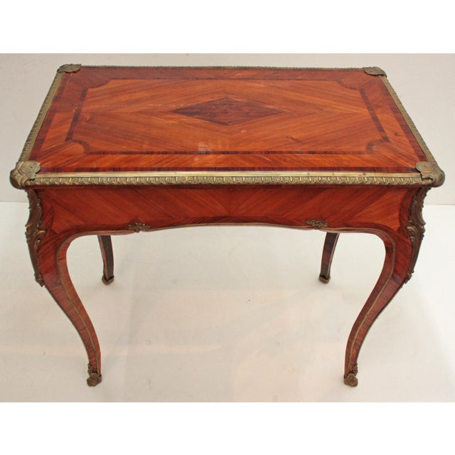 English Louis XV style table with a single drawer by the London firm of Town and Emanuel, originally importers of antique...