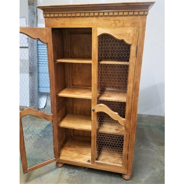 This is a classic French Country chicken wire cabinet made to store just about anything. It can be a kitchen or dining...