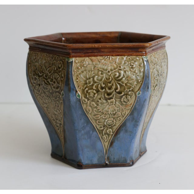 A superb circa 1900, English Art Nouveau cachepot or jardiniere by Royal Doulton. It is hand painted and signed by...