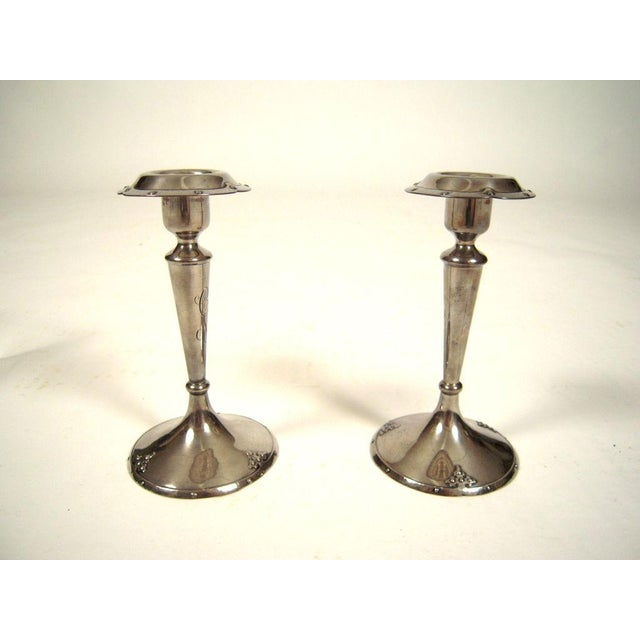 A pair of California Arts and Crafts period sterling silver candlesticks by Shreve and Co., San Francisco,circa 1910-20,...