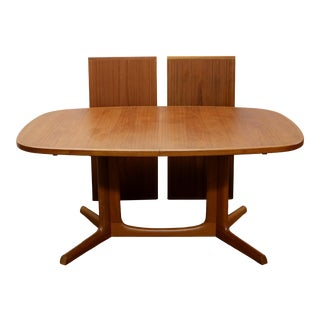1960s Niels Otto Moller for Gudme Mobelfabrik Teak Expanding Pedestal Mid-Century Dining Table For Sale