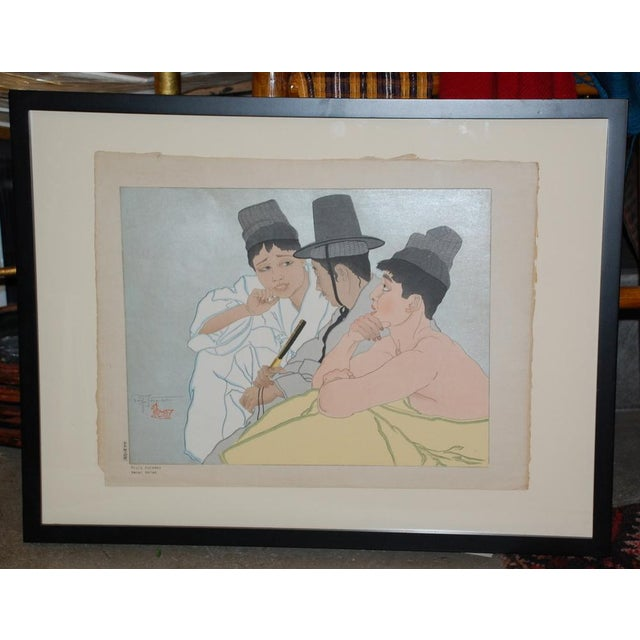 TROIS COREENS. SEOUL by Paul Jacoulet. Three Koreans, original color woodblock on handmade paper. Signed in pencil lower...