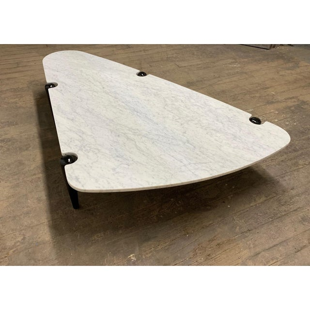 1960s Sculptural Carrara Marble Top Coffee Table. Has a black lacquered, solid walnut and iron frame.