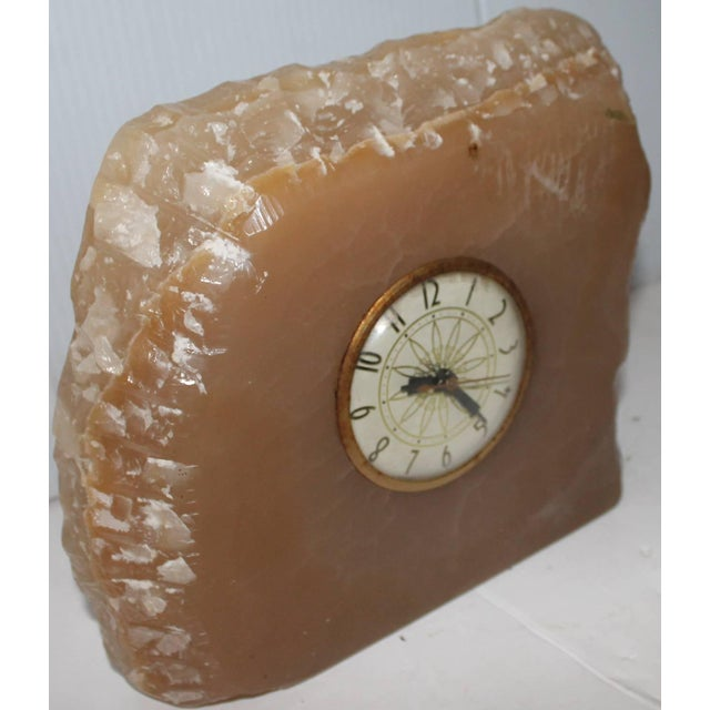 This quartz clock is in good condition as found and works. It is unsigned by the maker. It is a heavy piece of rock and...