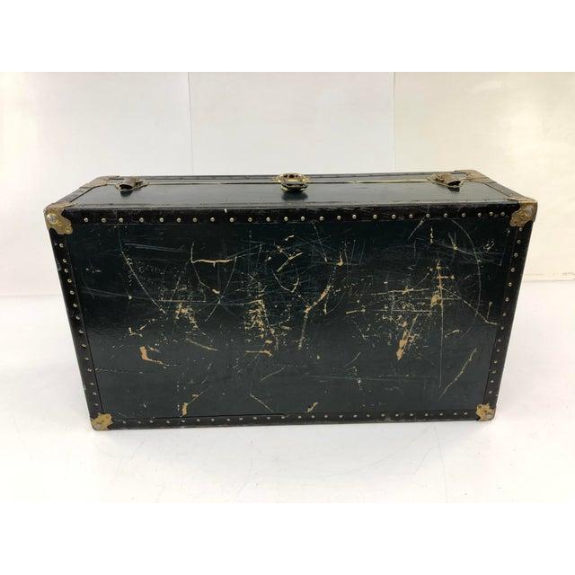 Vintage Black Steamer Trunk Amazing storage locker. Hardshell wood with black vulcanized material over. Has metal...