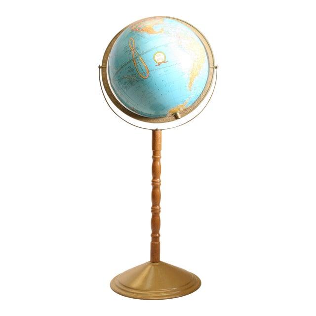 Vintage Revolving World Globe with Wood Pedestal Stand For Sale