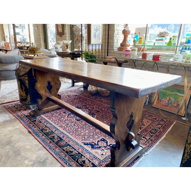 A 19th century walnut trestle table from Northern Italy,