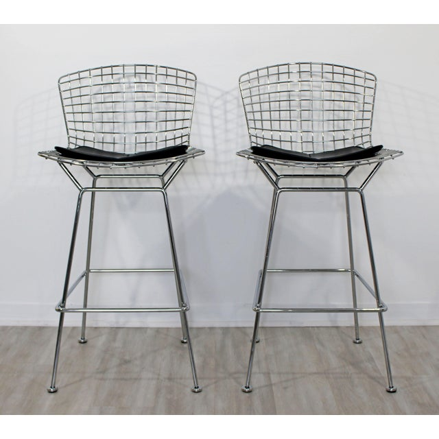 For your consideration is a marvelous pair of Harry Bertoia for Knoll bar stools, made of chrome and with angular black...