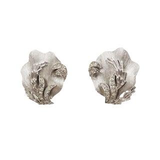 1960s Trifari Rhodium Plated & Rhinestone Shell Earrings For Sale
