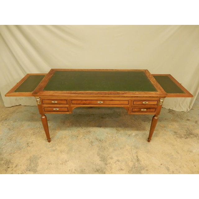 Nice size 19th century desk with slides on both sides. Desk has four drawers with locked compartment in large faux two...
