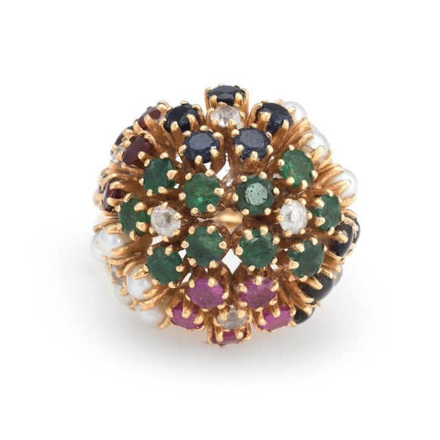 Finely detailed vintage domed cocktail ring (circa 1960s to 1970s), crafted in 18 karat yellow gold. Rubies, emeralds &...
