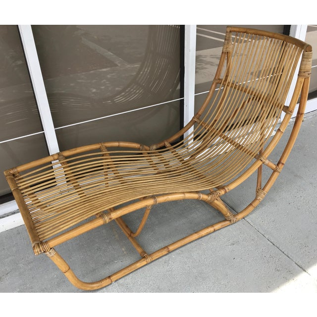 This is a stunning bamboo chaise by Franco Albini. The lines are clean and strong.