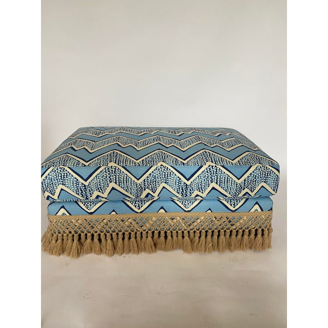 """Blue zig zag fabrication with jute tassel fringe. The top of this Ottoman has a 6"""" cushion that can be used either for..."""