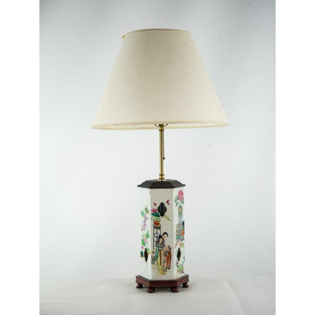 Bring a colorful narrative to your space with this Chinoiserie ginger jar table lamp. The unique and tall hexagonal shaped...