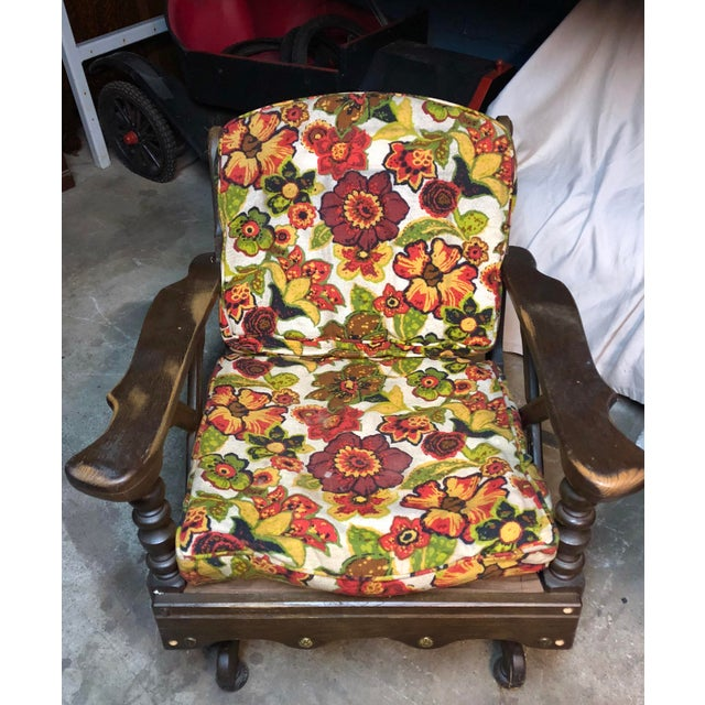 A midcentury floral bantam rocker with metal accents and unique legs.