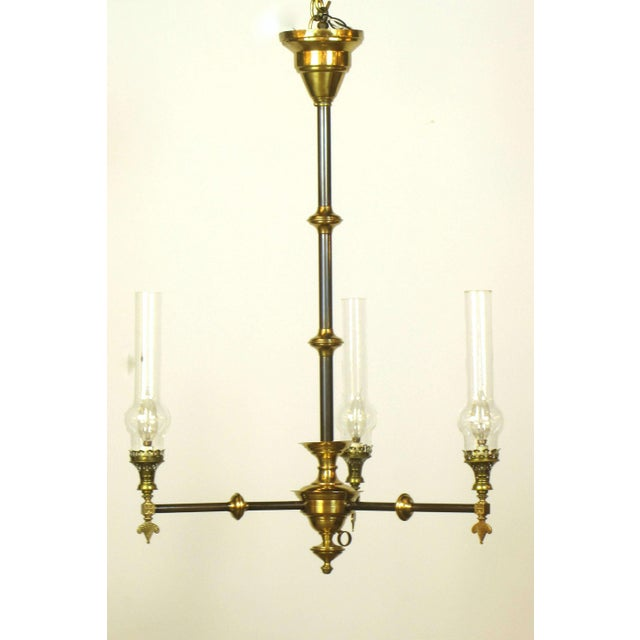 Aesthetic movement three light brass fixture with glass chimneys image 2 of 4