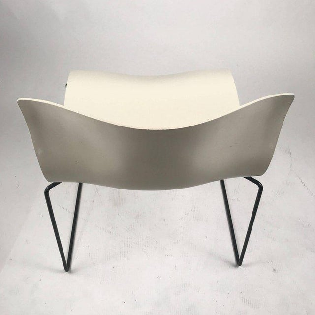 50 available stacking indoors /outdoors Knoll Vignelli handkerchief chairs in white with black wrought iron frame....